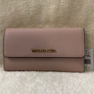 Michael Kors light pink trifold wallet